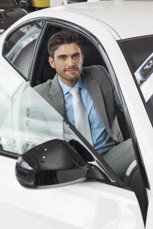 At the car dealer, Man sitting in new car - MLF000077