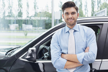 At the car dealer, Portrait of confident salesman - MLF000110