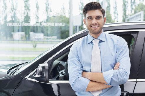 At the car dealer, Portrait of confident salesman - MLF000110