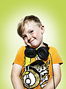 Smiling young boy with headphones - STKF000348