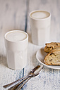 Cups of latte macchiatto with almond biscuits on wooden board - SBDF000199