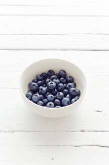 Studio, bowl of fresh blueberries on a white wooden table - CZF000076