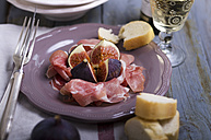 Sliced ham with figs, white bread and white wine - ODF000403