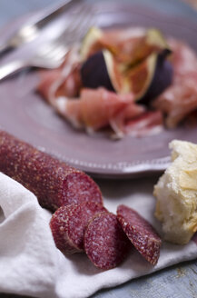 Salami with white bread, ham and figs in the background - ODF000402