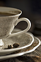 Cup of coffee and saucer with coffee beans - MYF000017