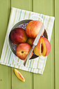 Peaches in strainer, close-up - ECF000326