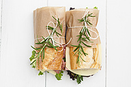 Baguette sandwiches with rosmary on white wood boards - ECF000329