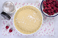 Raw short pastry in baking dish with raspberries and sugar - ODF000449
