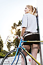 Young woman with racing bike - FEXF000048