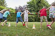 Children playing in garden on a birthday party - NHF001463