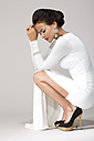 Woman wearing white gown, studio shot - MAE007264