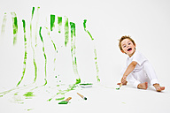 Toddler having fun with green paint - MVC000039