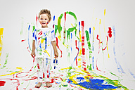 Toddler having fun with green paint - MVC000036
