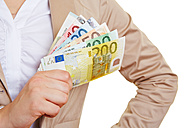 Female hand holding fanned euro notes - RKNF000110