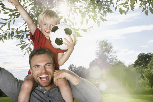 Germany, Cologne, Father and son playing soccer - PDF000401