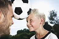 Germany, Cologne, Father and son playing soccer - PDF000410