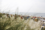 Germany, Lower Saxony, East Frisia, Langeoog, roofed wicker beach chairs at the beach - JAT000323