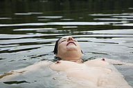 Germany, North Rhine-Westphalia, Cologne, Nude woman in a lake - JAT000364