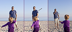 Denmark, Ringkoebing, little girl with her father playing on the beach - JFEF000216