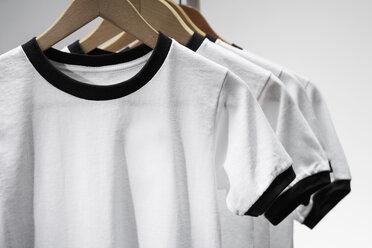 Football shirts on clothes hangers, studio shot - PDF000429