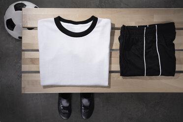 Football shirt, pants and shoes on bench, studio shot - PDF000432