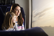 Mother and daughter in a train - KFF000274