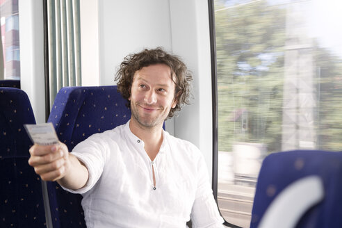 Man showing ticket in a train - KFF000254