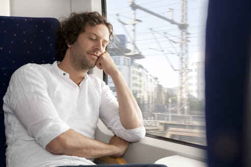 Relaxed man in a train - KFF000243