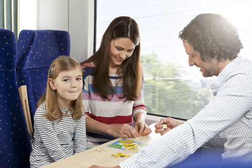 Happy family playing in a train - KFF000231