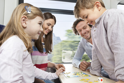 Happy family playing in a train - KFF000276