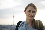 Germany, Berlin, Young woman on rooftop terrace, portrait - FKF000284