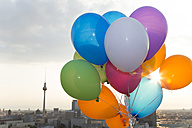 Germany, Berlin, View over city from rooftop terrace with balloons - FKF000261