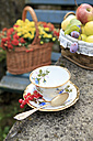 Germany, Bavaria, baskets with fresh fruits and flowers and a tea cup - VTF000035