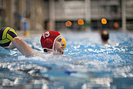 Water polo player in water throwing ball - SEF000052