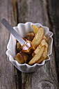 Grilled tofu sausage with curry sauce and potato wedges potatoes - ODF000521