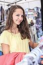 Germany, Thurinigia, Sonneberg, Brunette teenage girl shopping - VTF000040
