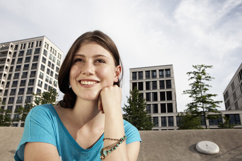 Germany, Bavaria, Munich, Smiling young woman outdoors - RBF001320