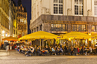 Germany, Saxony, Leipzig, People at outdoor cafe at night - WD001984