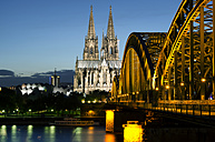 Germany, Cologne, View of Cologne Cathedral and Hohenzollern Bridge with River Rhine - ODF000540