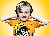 Portrait of little boy with headphones, studio shot - STKF000368