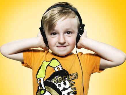 Portrait of little boy with headphones, studio shot - STKF000368
