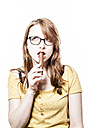 Young woman eating a chocolate bar - DISF000087