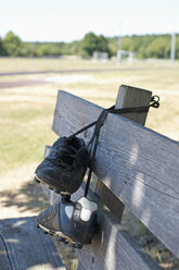 Germany, Bavaria, Munich, football shoes hanging on bench - ASF005195