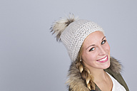 Portrait of young woman with bobble hat - DRF000250