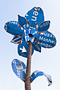 Germany, Munich, flower sculpture, old traffic signs during Tollwood Festifal - TC003589