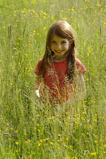 Germany, Upper Bavaria, Toelzer Land, girl in a flowering meadow - LB000349