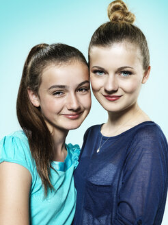 Potrait of two young female friends, studio shot - STKF000371