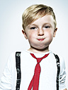 Portrait of little boy blowing his cheeks, studio shot - STKF000380