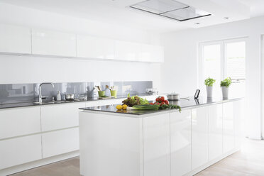 Germany, Cologne, Fruit and vegetables in kitchen - PDF000536