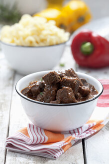 Goulash and noodles in bowls, close up - CSF020215